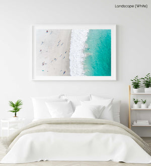 Aerial of green ocean at camps bay beach with people in cape town in a white fine art frame