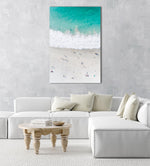Aerial of green ocean at camps bay beach with people in cape town in a natural fine art frame