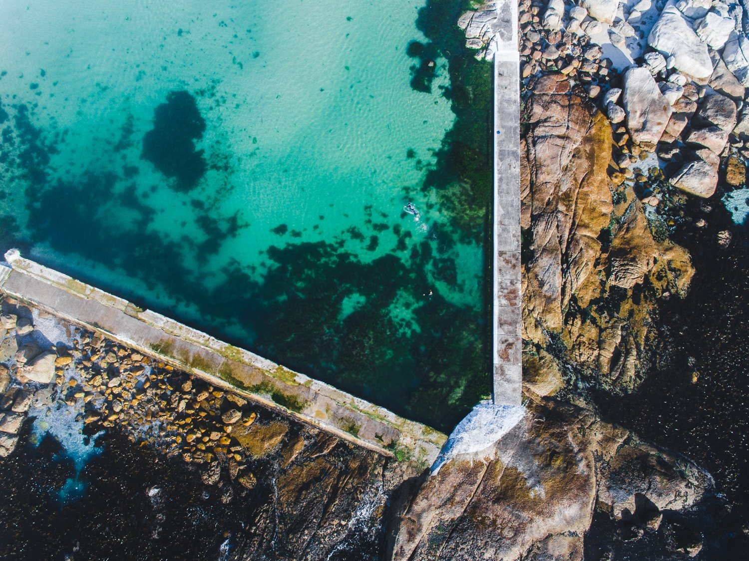 Aerial of camps bay green and blue tidal pool