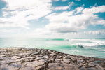 Turquoise waves breaking along arniston coast south africa
