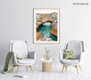 Turquoise water flowing through rock arch in arniston south africa in a natural fine art frame