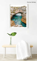 Turquoise water flowing through rock arch in arniston south africa in a white fine art frame
