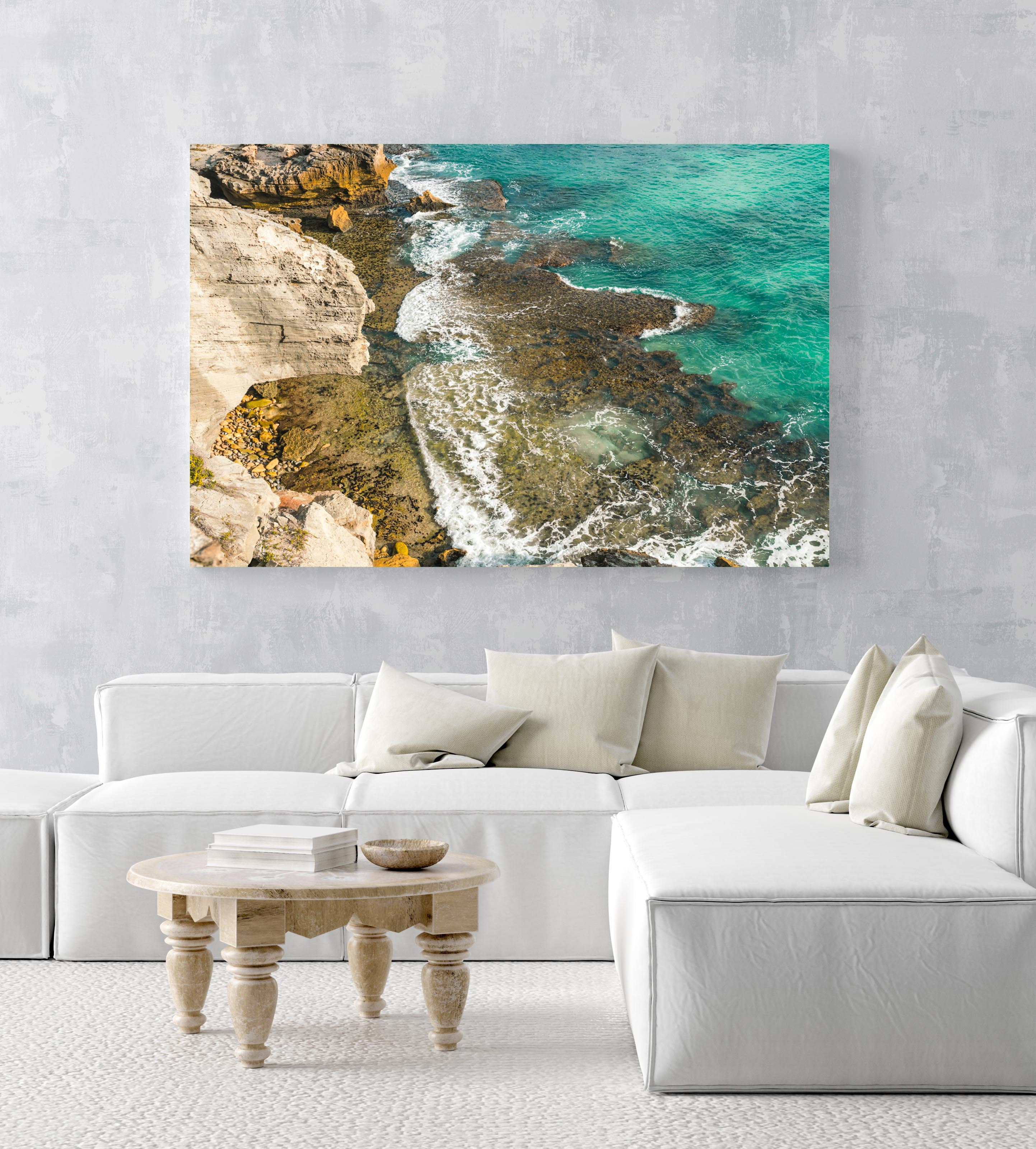 Turquoise water crashing on rocks in arniston south africa in an acrylic/perspex frame