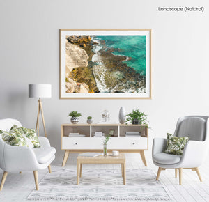 Turquoise water crashing on rocks in arniston south africa in a natural fine art frame