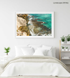 Turquoise water crashing on rocks in arniston south africa in a white fine art frame