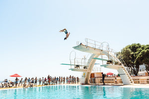 Boy doing backflip at blue Sea Point pools in cape town