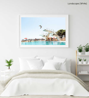 Boy doing backflip at blue Sea Point pools in cape town in a white fine art frame