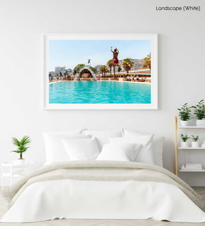 Two boys jumping in sea point pools during summer in cape town in a white fine art frame