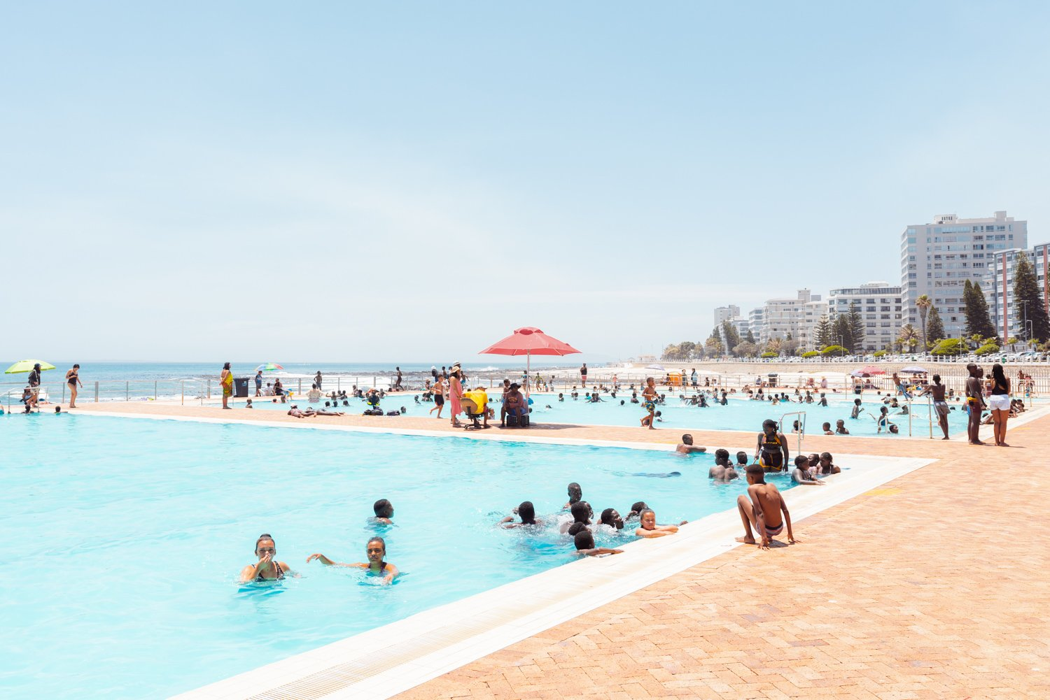 Lots of people in sea point pools on a hot day in cape town