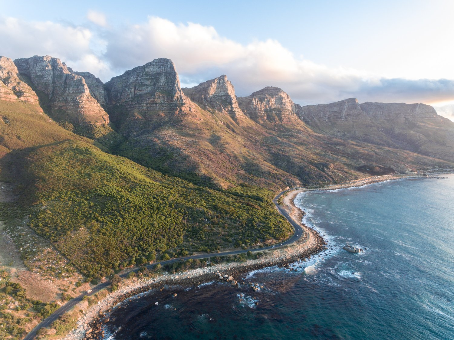Scenic road along the twelve apostles mountains in cape town during sunset