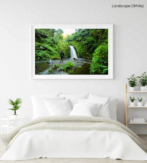 Green jungle and waterfall flowing in Mount Kenya in a white fine art frame