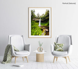 Big waterfall and green vegetation in Mount Kenya in a natural fine art frame