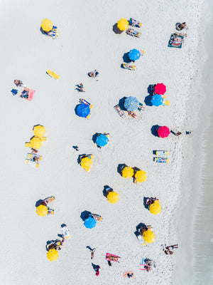 Aerial topdown of people tanning and umbrellas on Camps Bay beach