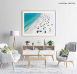 Aerial colorful umbrellas and people in sun on Camps Bay beach Cape Town in a natural fine art frame