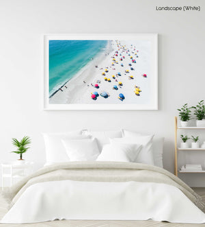 Aerial colorful umbrellas and people in sun on Camps Bay beach Cape Town in a white fine art frame