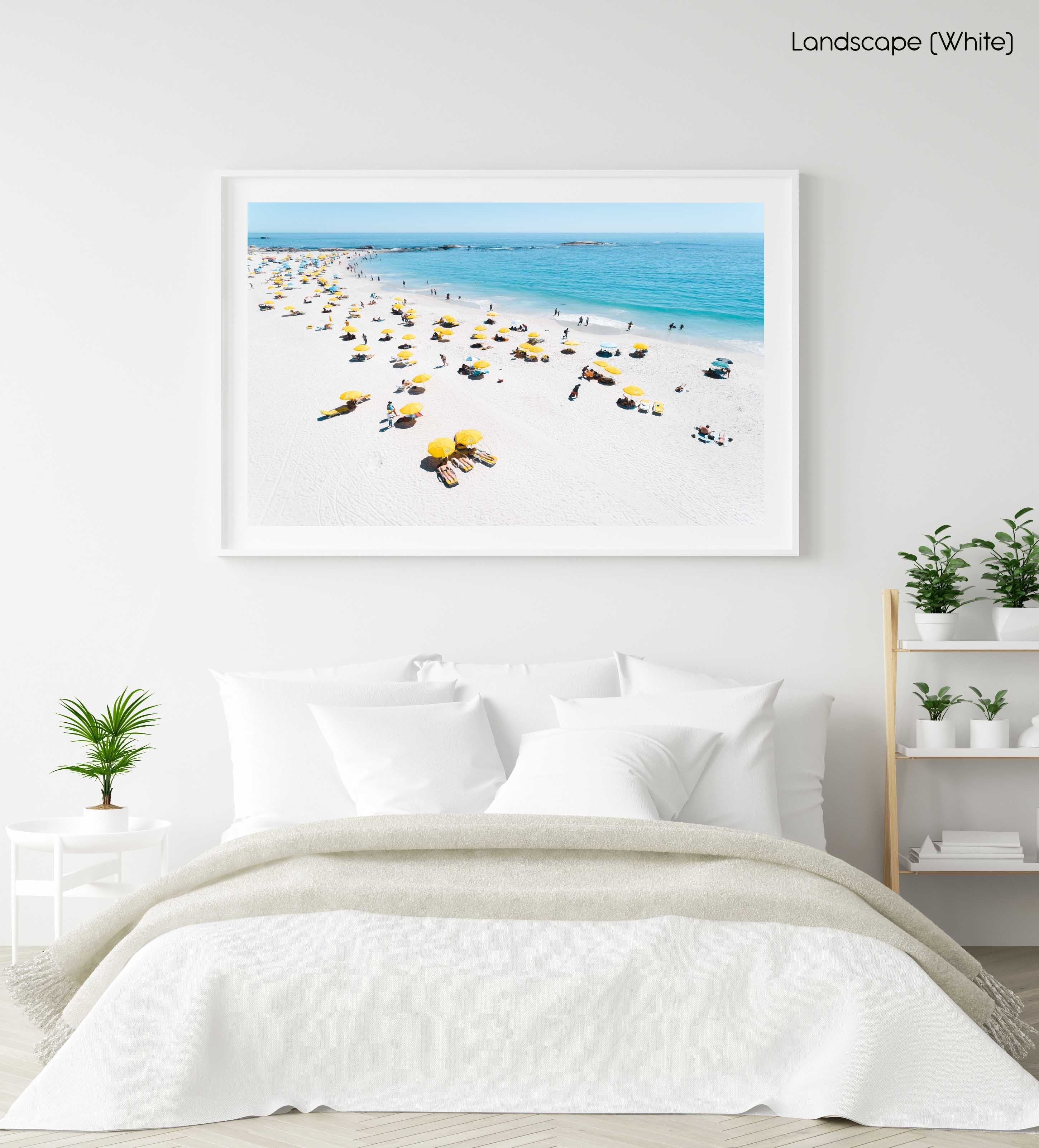 Aerial of yellow umbrellas, white sand and blue sea in Camps Bay Cape Town in a white fine art frame
