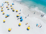 Blue and yellow umbrellas on Camps Bay beach Cape Town from above
