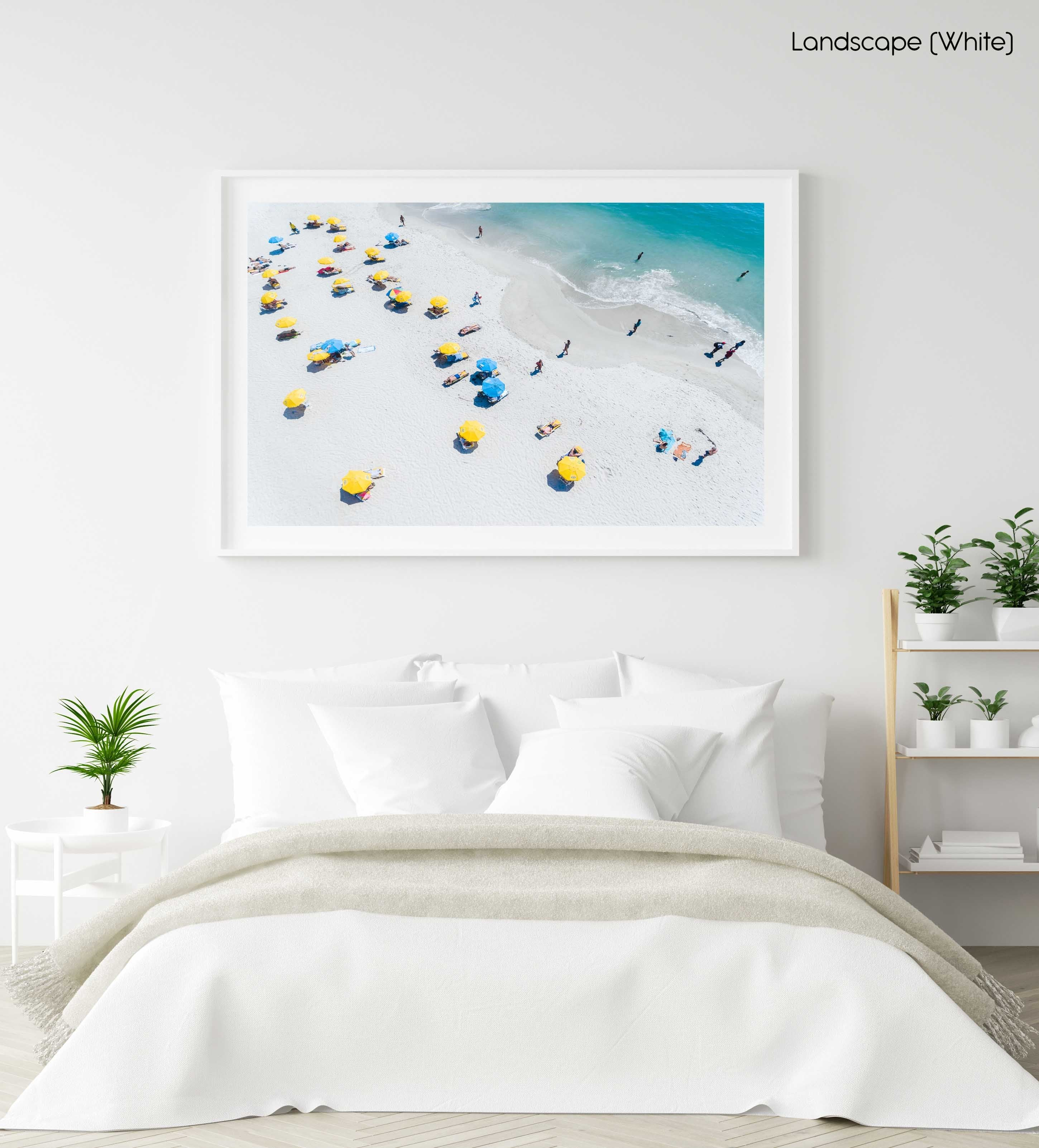 Blue and yellow umbrellas on Camps Bay beach Cape Town from above in a white fine art frame