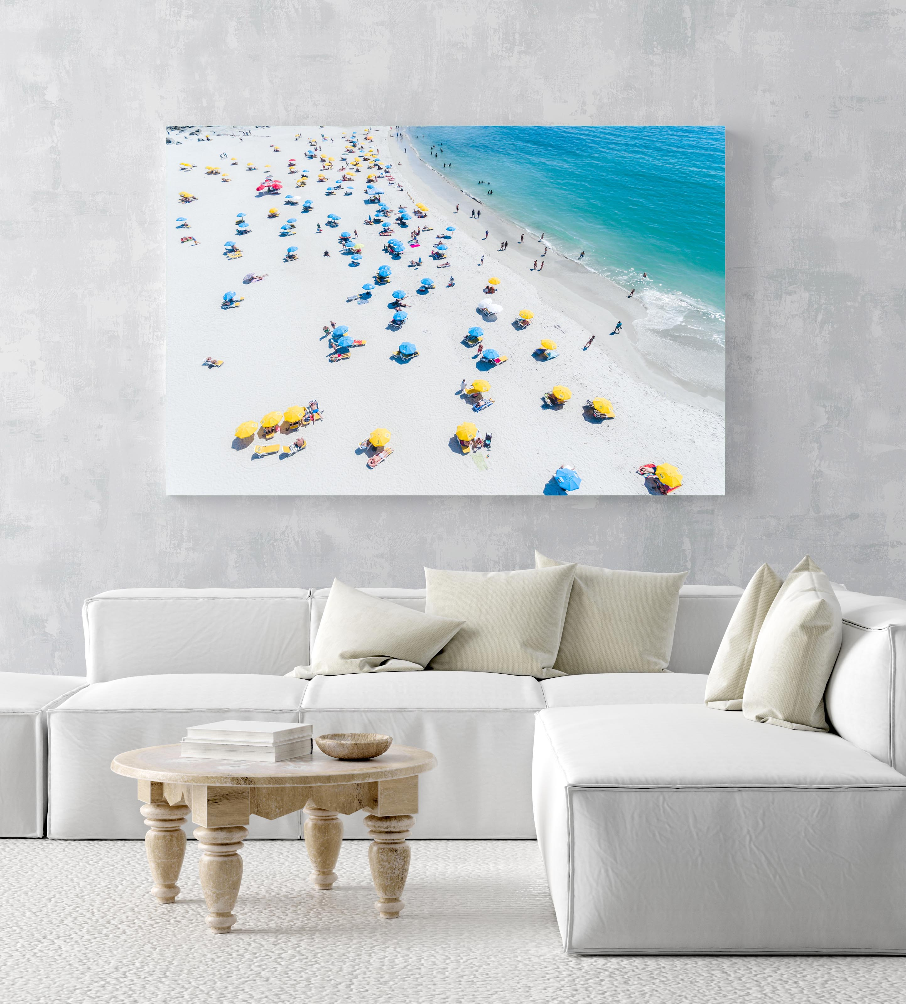 Aerial busy umbrellas and people on white sandy beach in an acrylic/perspex frame