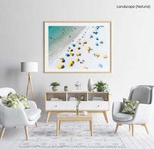 Aerial of green sea and colorful umbrellas from above on Camps Bay beach in a natural fine art frame