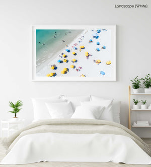 Aerial of green sea and colorful umbrellas from above on Camps Bay beach in a white fine art frame