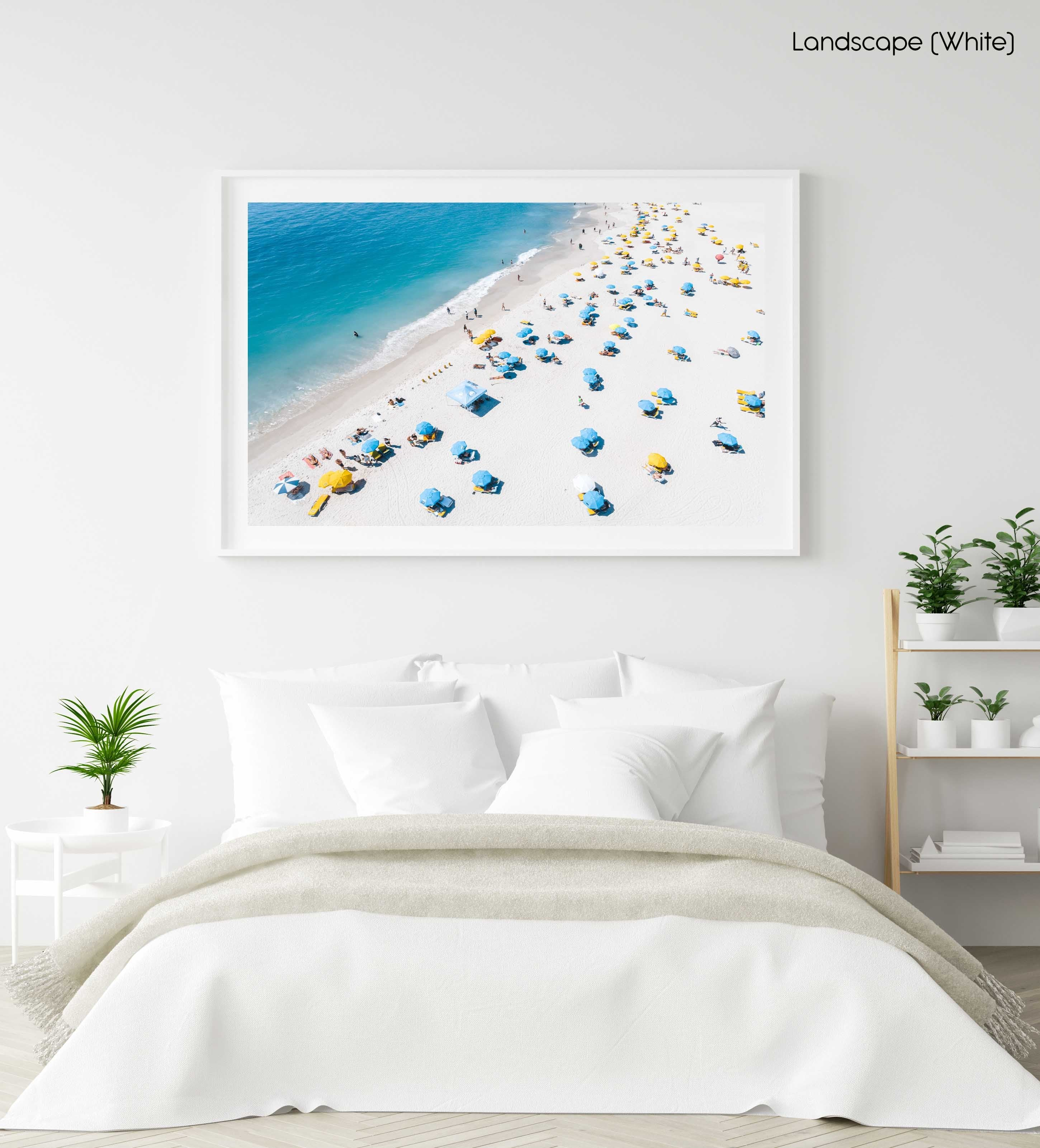 Blue and yellow umbrellas from above on summer day in cape town in a white fine art frame