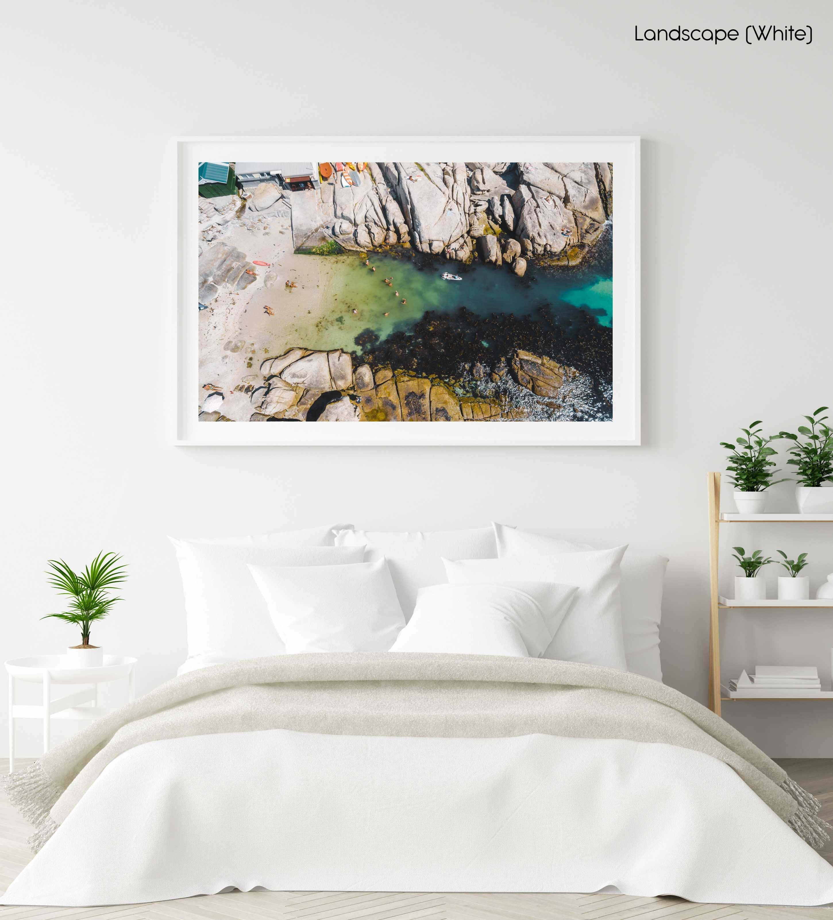 Swimmers from above at Beta Beach in Cape Town in a white fine art frame