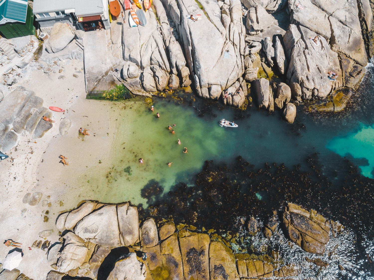 Swimmers from above at Beta Beach in Cape Town