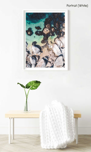 Boulders and people from above at green sea in Oudekraal Cape Town in a white fine art frame