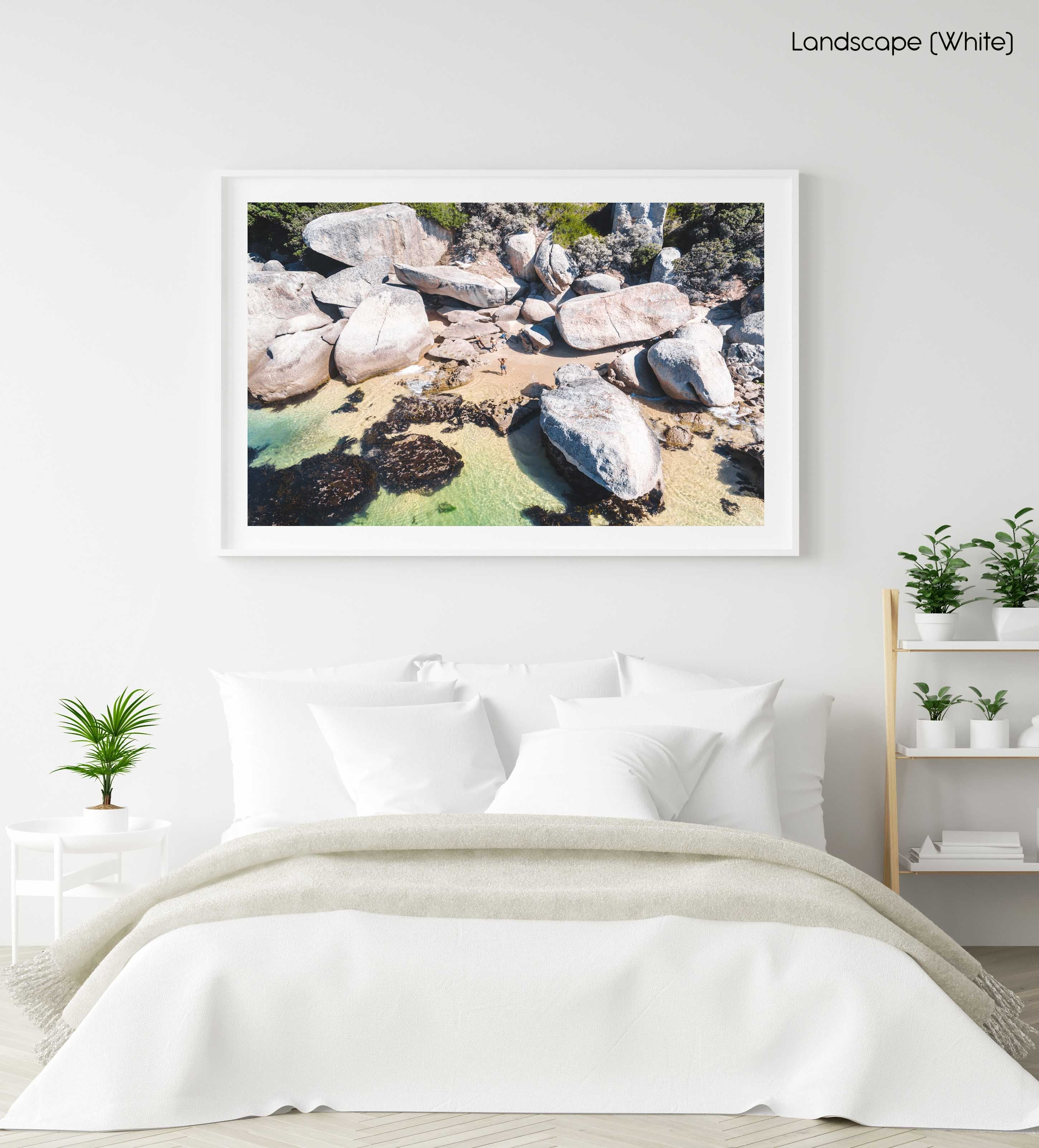 Secret Beach with people and green water in Oudekraal Cape Town in a white fine art frame