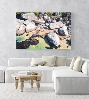 Secret Beach with people and green water in Oudekraal Cape Town in an acrylic/perspex frame