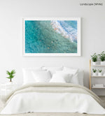 Surfers from above in blue turquoise sea at Manly beach sydney in a white fine art frame