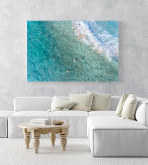 Surfers from above in blue turquoise sea at Manly beach sydney in an acrylic/perspex frame