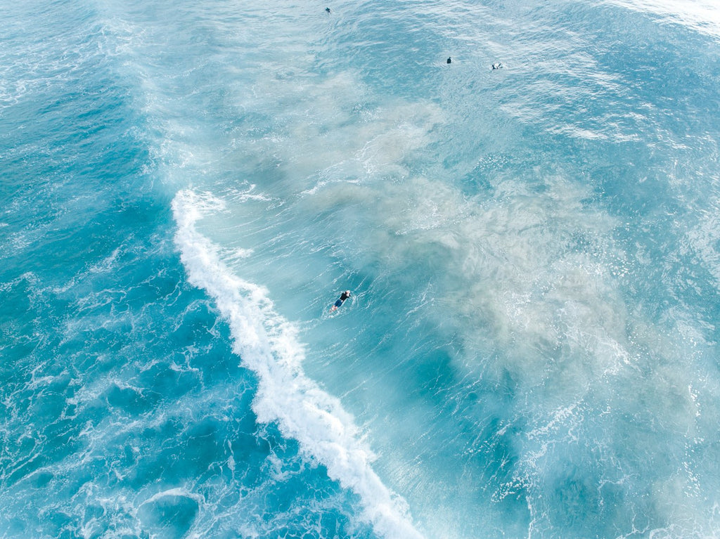 Surfers on whitewash from above in Sydney Australia