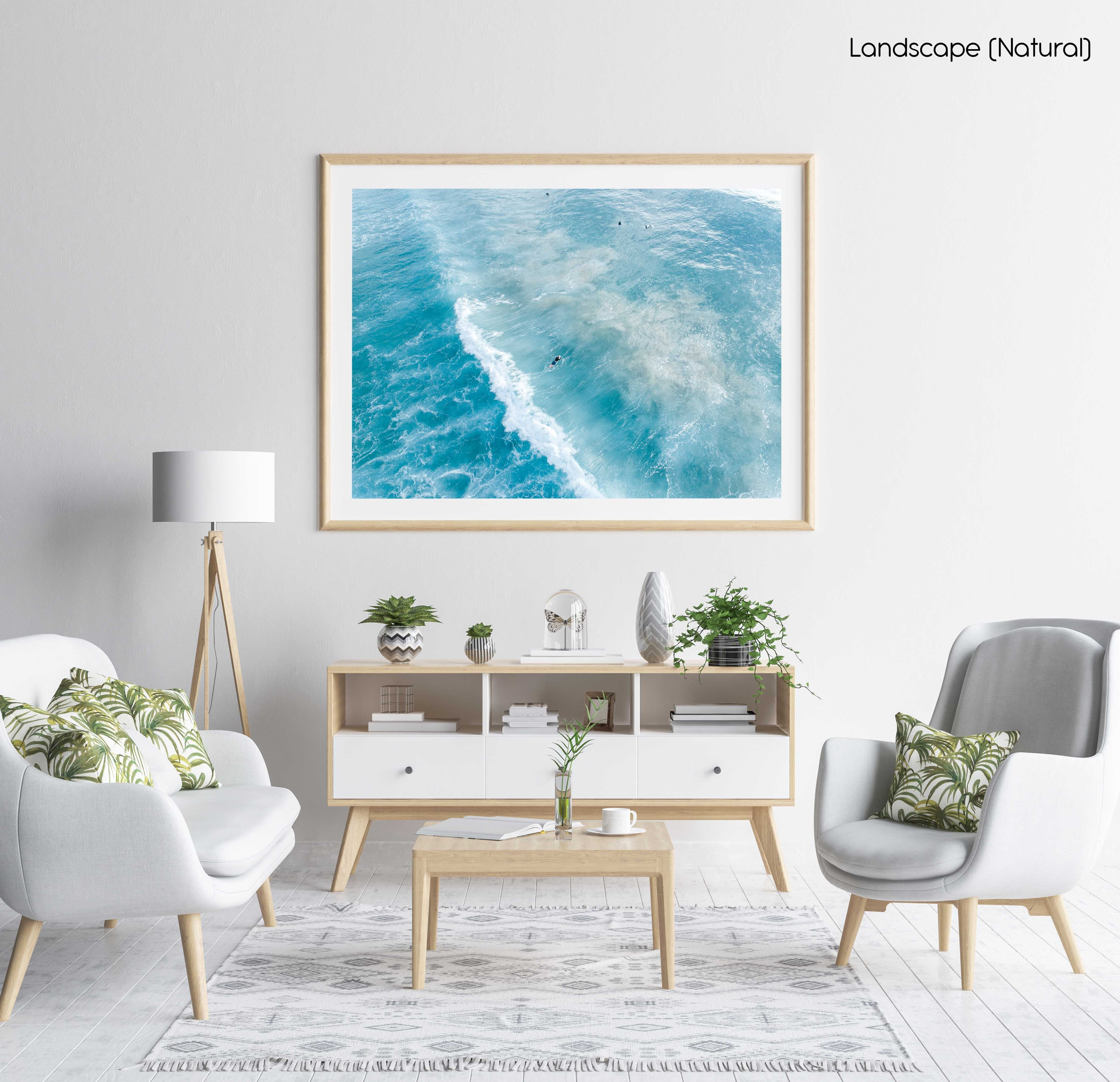 Surfers on whitewash from above in Sydney Australia in a natural fine art frame