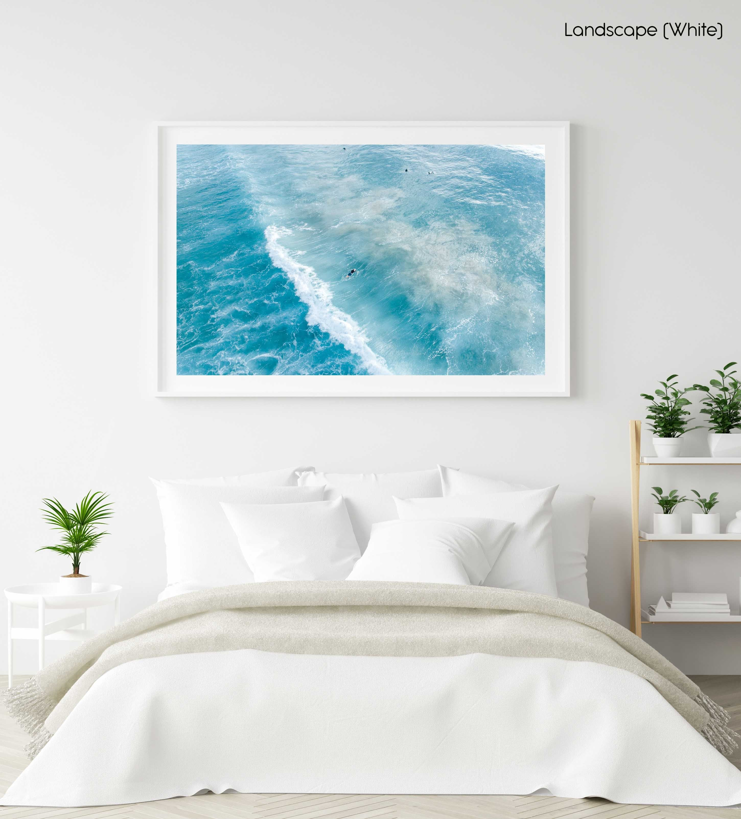 Surfers on whitewash from above in Sydney Australia in a white fine art frame