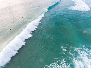 Dark green and blue whitewash rolling through Manly Beach surf