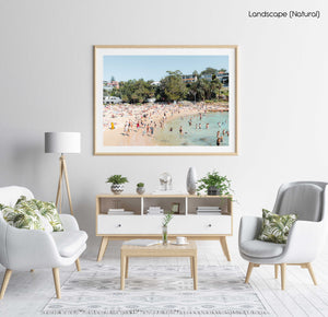 Shelly beach goers on a hot summers day in sydney in a natural fine art frame