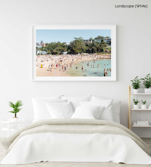 Shelly beach goers on a hot summers day in sydney in a white fine art frame