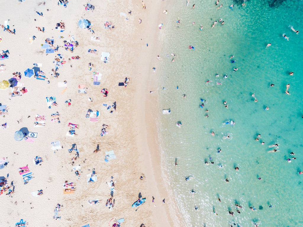 Aerial topdown of blue water and tanning people at Shelly Beach Manly Sydney