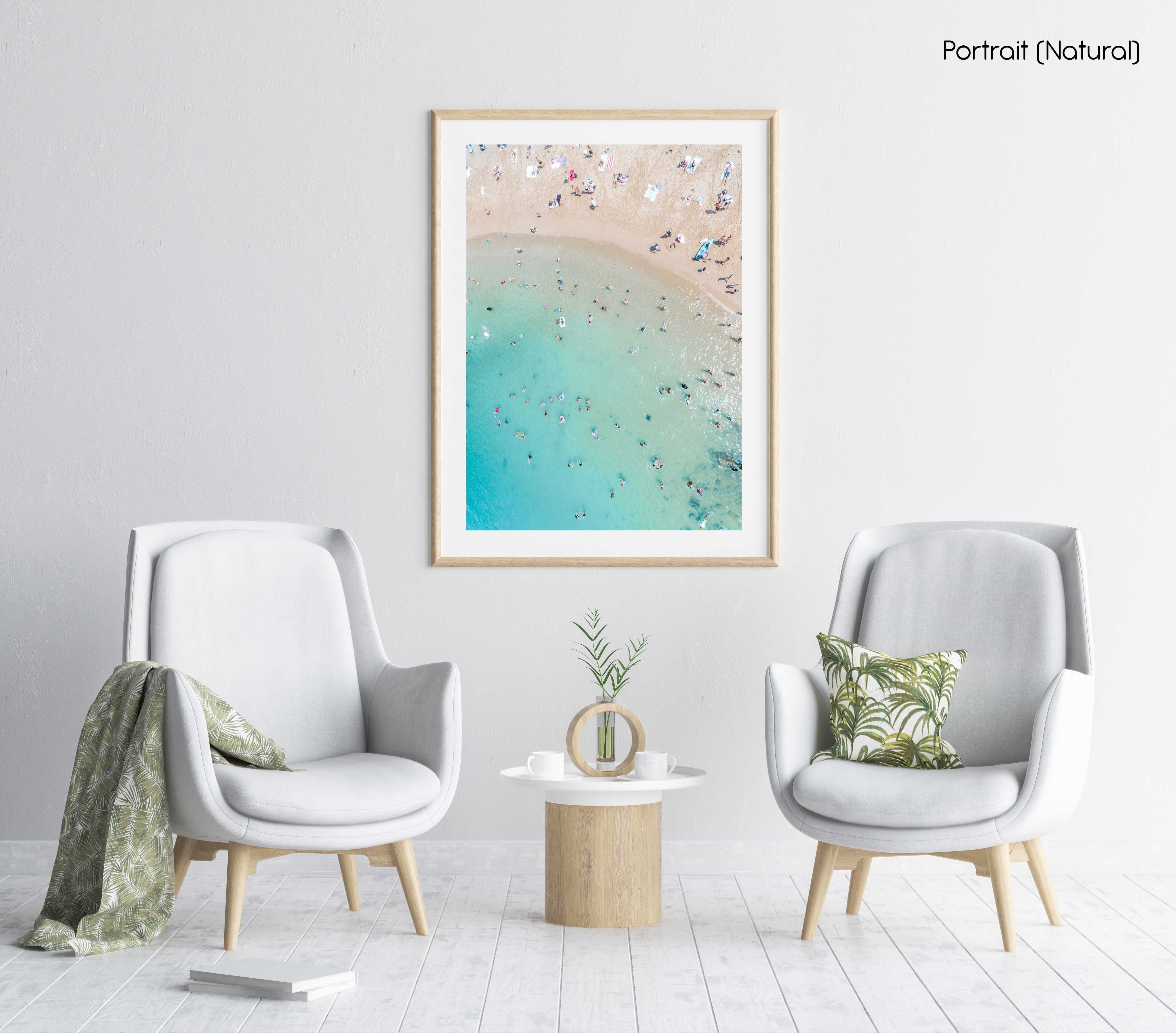 Aerial topdown of blue sea and people swimming at the beach in Sydney in a natural fine art frame