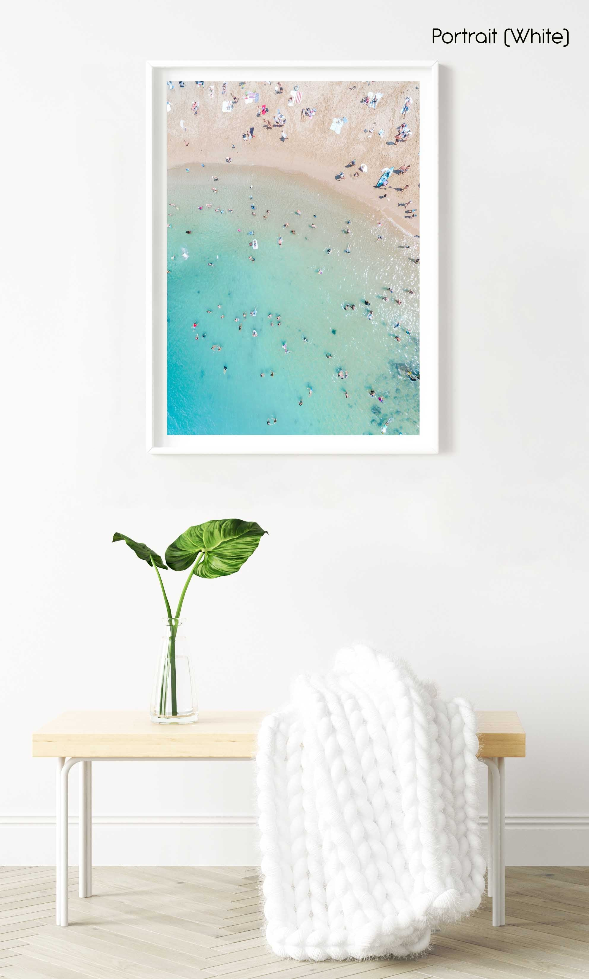 Aerial topdown of blue sea and people swimming at the beach in Sydney in a white fine art frame