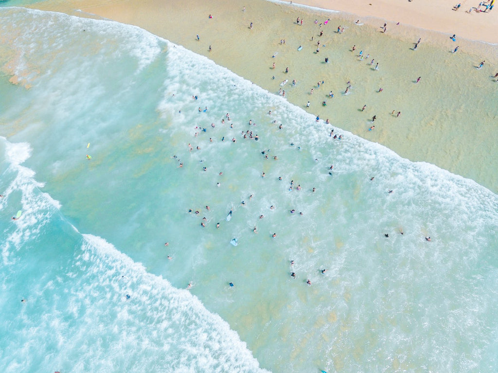Lots of swimmers in the waves at Manly Beach in Sydney