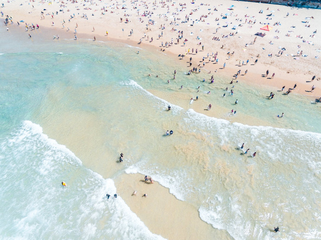 Many swimmers in the waves at Manly Beach in Sydney