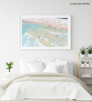 Many swimmers in the waves at Manly Beach in Sydney in a white fine art frame