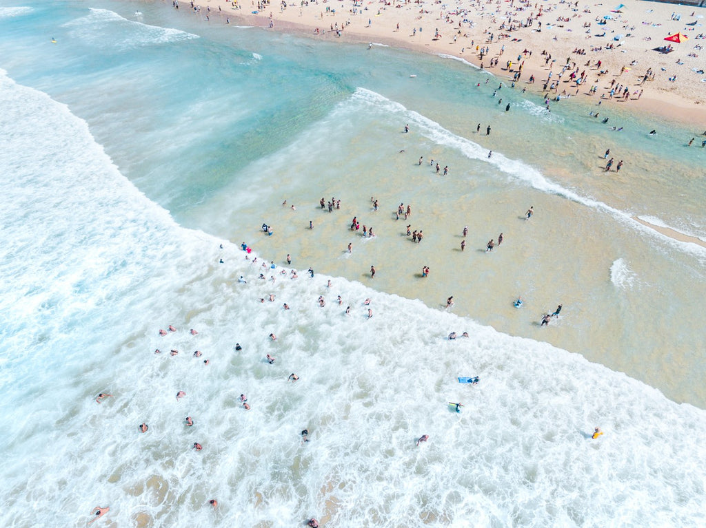 Crowd of swimmers in the waves at Manly Beach in Sydney