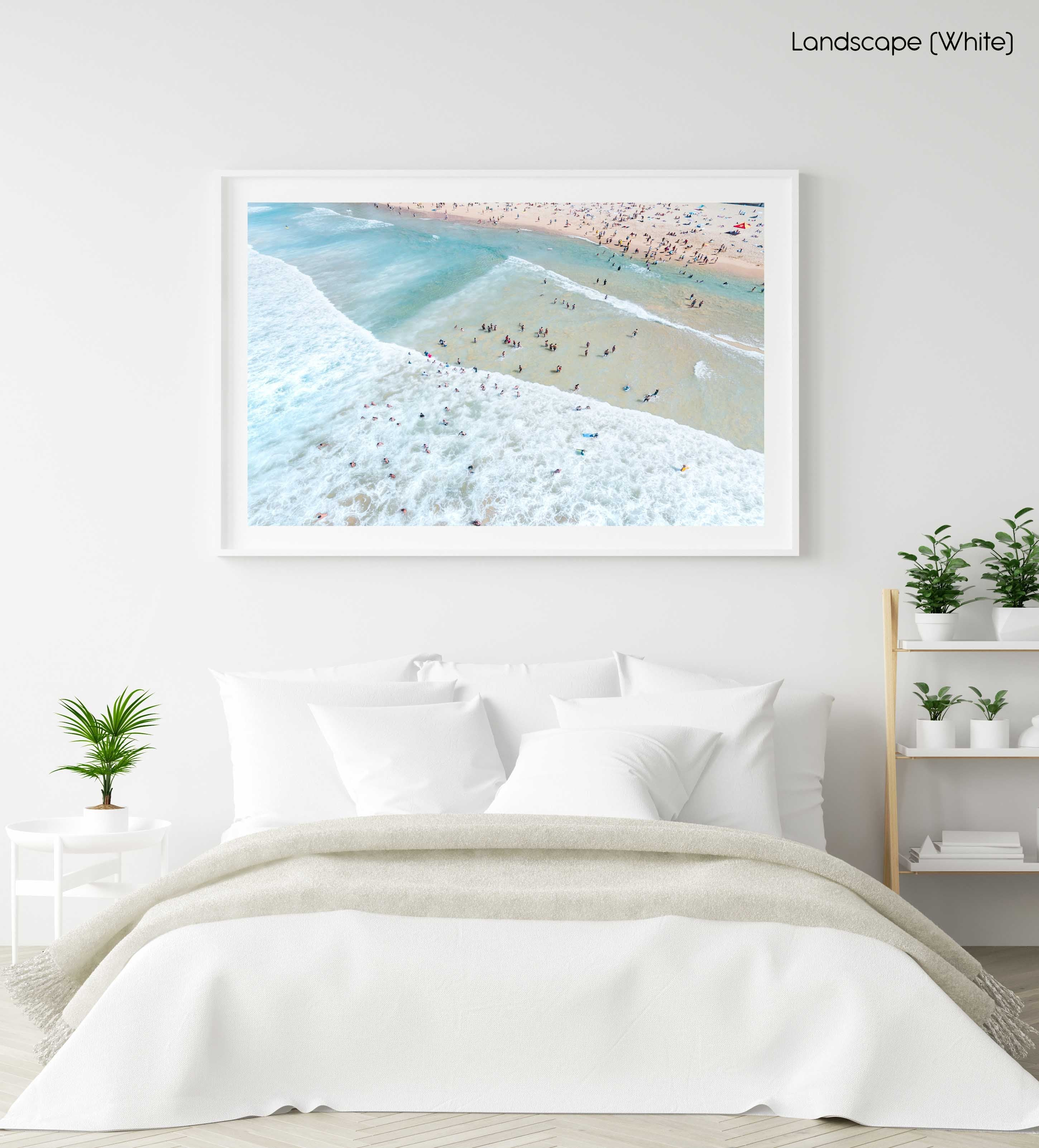 Crowd of swimmers in the waves at Manly Beach in Sydney in a white fine art frame