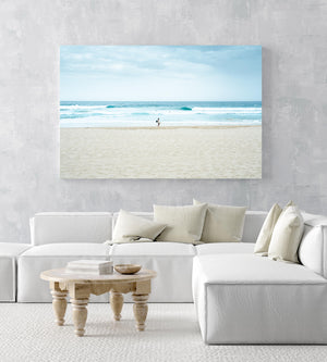 Man with surfboard looking out to blue waves along Manly Beach in Sydney in an acrylic/perspex frame