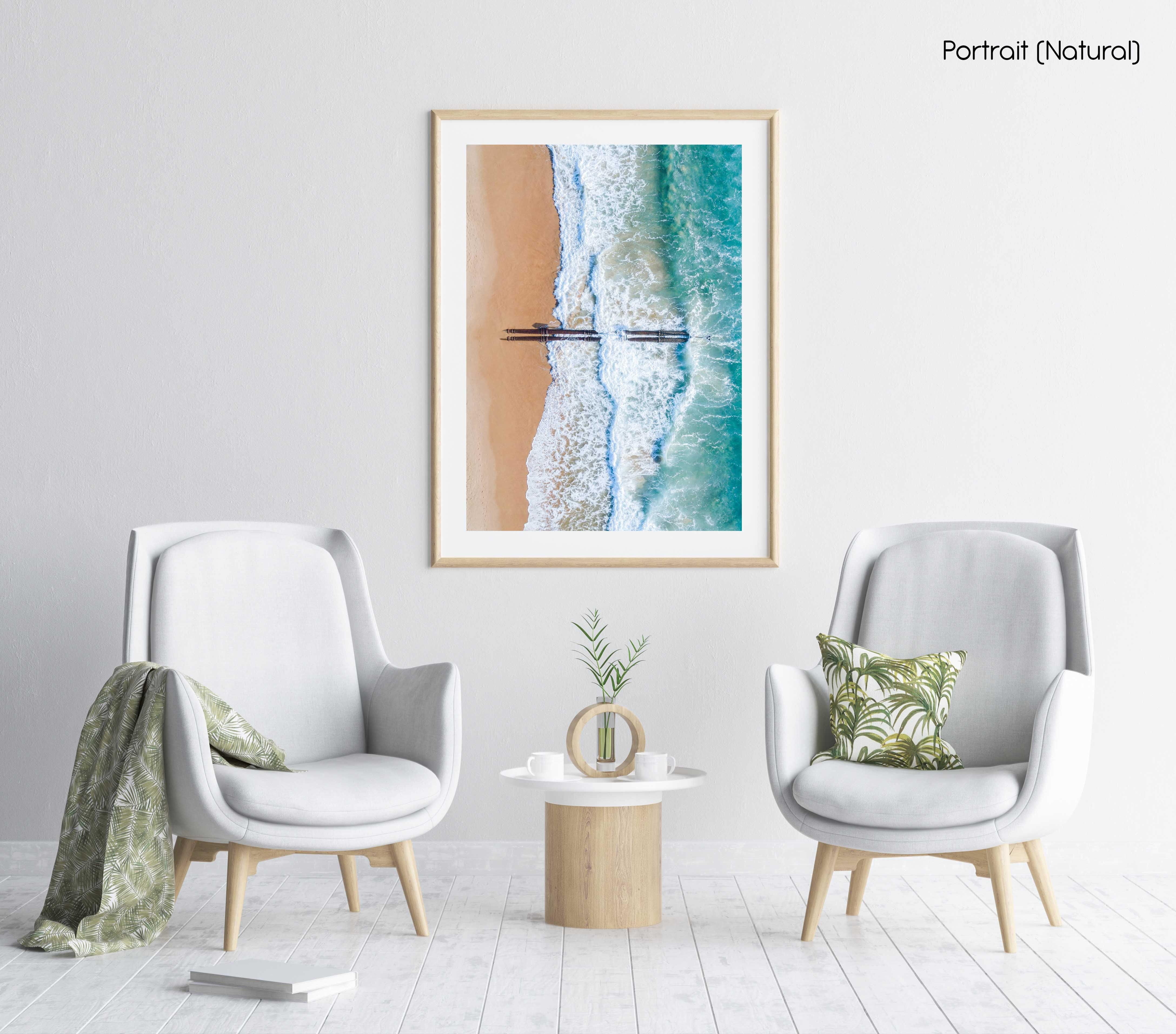 Aerial of beach pipes in ocean waves on Manly Beach Sydney in a natural fine art frame