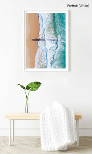 Aerial of beach pipes in ocean waves on Manly Beach Sydney in a white fine art frame